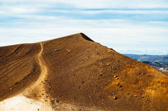Path climbing up a volcanic hill. A steep path that climbs up a mountain of rocks, in Iceland Royalty Free Stock Photography
