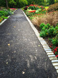 Path in a colorful summer garden Stock Photo
