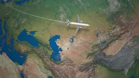 Route of commercial airplane flying from London to Beijing the Earth globe stock footage