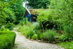 Path and cottage in natural garden Royalty Free Stock Images