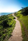 Walkway curves to go for a hike in Praia do Santinho, Florianópolis, Brazil stock photos