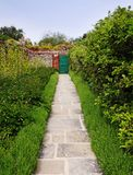 Path and doorway in an English Walled Garden Royalty Free Stock Image