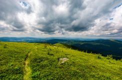 Path down the hill among the rocks. Lovely mountain landscape in summer Royalty Free Stock Images