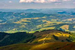 Path down the hillside to picturesque valley. Lovely warm evening on the Carpathian Borzhava ridge in late summer weather Stock Image