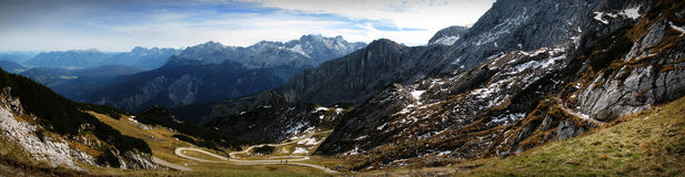 The Path Down the Mountain. A Panoramic shot of the path leading down the mountain from the Alspitz.  This is how many Germans exercise Royalty Free Stock Images