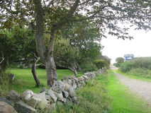 Path and drystone wall Royalty Free Stock Photography