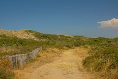 Path through the dunes along the Opal North Sea coast. Nord pas de Calais, France, on a sunny day with clear blue sky stock images