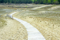 Path through the dunes. The path through the dunes. Desert, sand and dunes Royalty Free Stock Photos