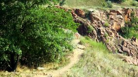 The path on the edge of cliffs stock footage