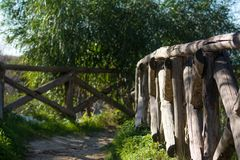 Path Enclosed By A Wooden Fence stock images