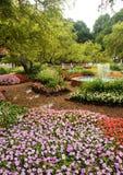 Path Through the Flowers. A brick path winding through the garden Stock Image