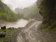 Path in fog. Foggy day danger route in Swanetia region - Georgia Caucasus Royalty Free Stock Photo