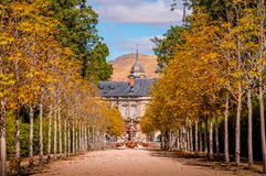 Path through the forest that reaches the Royal Palace of La Granja de San Ildefonso in Segovia, Spain. stock photo