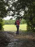 Path in the forest where female trekker will take Royalty Free Stock Images