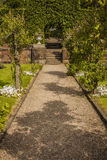 Path through formal garden to steps at Biddulph Grange Stock Image