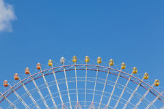 Path of funfair giant ferris wheel against blue sky. Background Stock Images