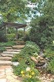 Path through the garden. Image of a stone walkway in an oriental garden Stock Photo