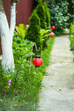 The path in the garden. The garden paths near hanging small red lanterns Stock Photo
