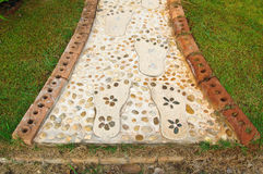 The path in the garden. Stone walkway Royalty Free Stock Photography