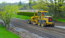 The path gets a makeover. The road workers redo an asphalt road. In the photo we cup the earth to be able to put back the asphalt. Photo taken in spring 2017 Stock Photography