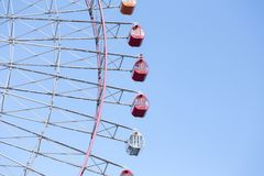 Path of Giant wheel against clear blue sky Stock Photo