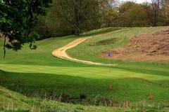 Path through the golf course Stock Photo