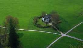 Path, grass and house. This scenery is in Salzburg royalty free stock photography
