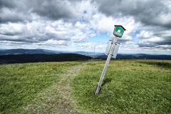 Path on the grass with the oblique sign proibiting the steps Royalty Free Stock Photos