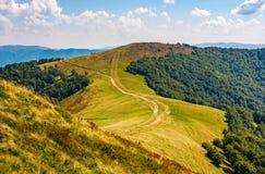 Path through grassy meadows on mountain ridge Royalty Free Stock Photo