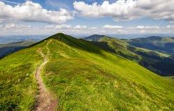 Path through the grassy mountain ridge Stock Image