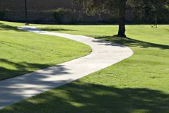 Path through green grass stock images
