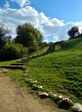 Path on a green hill Stock Images