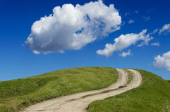 Path on the green hill Royalty Free Stock Photos