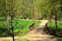 Path in a green park. Walk path through the green park in a sunny day. Vlasim castle park stock photo