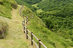 Path and handrail in village Elcito. Path and wooden handrail in village Elcito, Italy, Marche stock photography