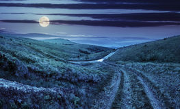 Path through highland meadows at night Stock Images