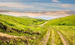 Path through highland meadows at sunrise Stock Image