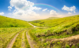 Path through highland meadows at sunrise Stock Photos