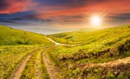 Path through highland meadows at sunset Royalty Free Stock Photos