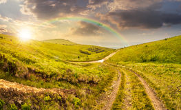 Path through highland meadows at sunset Royalty Free Stock Images