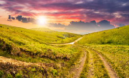 Path through highland meadows at sunset Stock Photography