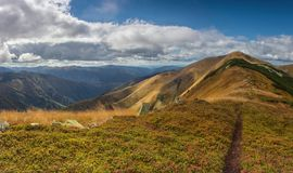 Path in the highlands. Mountain slopes in autumn in Ukrainian Carpathians Royalty Free Stock Photography
