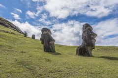 Pair of underground moai on the extinct volcano Rano Raraku. Path on the hill of the moais of the Rano Raraku volcano where all the moai were sculpted stock images
