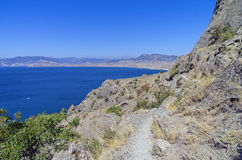 The path on the hillside above the sea. Royalty Free Stock Images