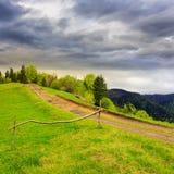 Path on hillside meadow in mountain Stock Image