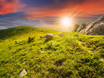 Path through hillside with white boulders at sunset Stock Photography