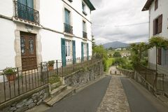 Path between homes in Sare, France in Basque Country on Spanish-French border, a hilltop 17th century village in the Labourd provi Stock Photos