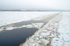 Path on the ice from the ship. The river was the icebreaker.He broke the ice for other vessels Stock Photos