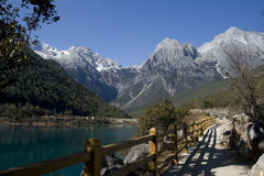 Path by lake at Jade Dragon Snow Mountain. Lake at Baishui (White River) Jade Dragon Snow Mountain, Lijiang, Yunnan, China stock photo