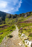 Path, lake and mountains, Cwm Idwal and the Devil's Kitchen. stock photography